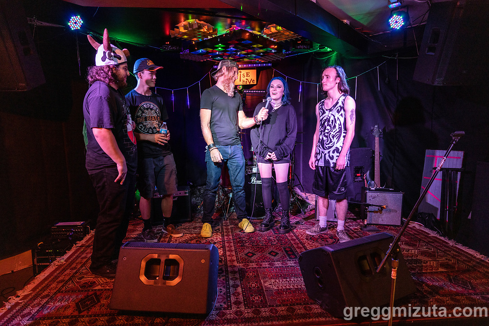 Avrie Davis (L to R: Kyler Garcia, Dylan Smith, Avrie Davis, Gabrial Warren) are interviewed following their performnace at the Boise Hive, Boise, Idaho on August 21, 2021.<br /> <br /> Avrie Davis (vocals, guitar), Dylan Smith (bass), Kyler Garcia (guitar), and Gabrial Warren (drums).