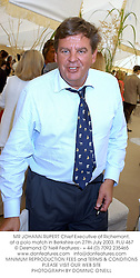 MR JOHANN RUPERT Chief Executive of Richemont, at a polo match in Berkshire on 27th July 2003.PLU 467
