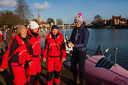 Marlow, Bucks, January 24th 2015. Olympic and Paralympic rowing medallists including Naomi Riches, Heather Stanning and Katherine Grainger join members of a Coxless Crew at Marlow at their boat naming ceremony. The Coxless Crew is a team of four women who have given up their jobs to undertake an epic six-month 8,446 mile adventure rowing their boat Doris across the Pacific ocean from Sanfrancisco to Cairns in Australia, to raise funds for charities Walking With The Wounded and Breast Cancer Care. PICTURED: Coxless Crew members Natalia Cohen, L, Laura Stanning and Emma Mitchell celebrate the naming of their boat Doris, with Olympic medallist Heather Stanning.