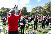 Conductor David Hill, conducts a two-minute silence for the Let Music Live campaign, raising awareness of the need for targeted support for freelance musicians during the coronavirus pandemic and calling on the Government to recognise that freelance musician is an economic asset. The performance was concluded in Parliament Gardens, outside the Houses of Commons in London, on Tuesday, Oct 6, 2020.  Musicians in Britain are using their voices and instruments to protest against the government instructions to retrain and lack of support to the industry. (VXP Photo/ Vudi Xhymshiti)
