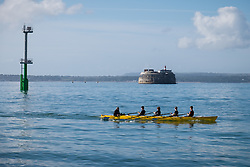 © Licensed to London News Pictures. 11/09/2016. Portsmouth, UK.  A group of young men rowing in the Solent off Southsea promenade in Portsmouth this morning, 11th September 2016.  Photo credit: Rob Arnold/LNP