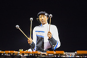May Lee, senior, plays the marimba during the marching band's halftime performance during the Milpitas High School varsity football game against Mountain View High School on Oct. 5, 2012 in Milpitas, Calif.  The Trojans would go on to win 42-7.  Photo by Stan Olszewski/SOSKIphoto.