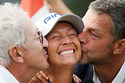Franck Riboud and Jacques Bungert kiss the winner Angela Stanford during the final round of LPGA Evian Championship 2018, Day 7, at Evian Resort Golf Club, in Evian-Les-Bains, France, on September 16, 2018, Photo Philippe Millereau / KMSP / ProSportsImages / DPPI