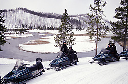 Yellowstone snowmobilers enjoy the view of the Firehole River Valley in Yellowstone National Park