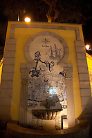 Frescoes and fountain in a laneway near Senado Square in historic Macau.