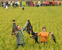 Oct. 3, 2017 - Huai'an, China - Tourists show ducks they caught in Hongze District of Huai'an City, east China's Anhui Province. Various activities are held around China during the National Day holiday. This year it has been extended by one more day as the Mid-Autumn Festival falls on Oct. 4th. (Credit Image: © Chen Liang/Xinhua via ZUMA Wire)
