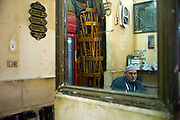 A man sits inside the El Nadawa El Thaqafiya cafe, Cairo, Egypt