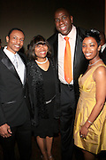 """Bobby, Velma Clarke, Magic Johnson and Felicia Fletcher at The Ludacris Foundation 5th Annual Benefit Dinner & Casino Night sponsored by Alize, held at The Foundry at Puritan Mill in Atlanta, Ga on May 15, 2008.. Chris """"Ludacris"""" Bridges, William Engram and Chaka Zulu were the inspiration for the development of The Ludacris Foundation (TLF). The foundation is based on the principles Ludacris learned at an early age: self-esteem, spirituality, communication, education, leadership, goal setting, physical activity and community service. Officially established in December of 2001, The Ludacris Foundation was created to make a difference in the lives of youth. These men have illustrated their deep-rooted tradition of community service, which has broadened with their celebrity status. The Ludacris Foundation is committed to helping youth help themselves."""