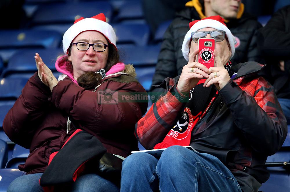 Sheffield United fan's in the stands wearing festive santa hats