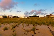 Beach houses behind the dand dunes on Long Beach Island early in the morning