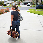 A hair dresser makes house calls the first week of April in Los Angeles after the salon she rents space from closed its doors on March 19 as a non-essential business. Faced with having to pay rent for her spot at the closed salon plus her home mortgage, the hair dresser felt she had little choice but to disregard the Safer At Home order and work clandestinely to earn income.