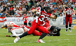 11.07.2011, UPC Arena, Graz, AUT, American Football WM 2011, Group B, Kanada (CAN) vs Oesterreich (AUT), im Bild Matt Walters (Canada, #33, RB) running with ball, Roman Meklau (Austria, #89, 54, DT) on the grass and Josh Buttrill (Canada, #65, OL) coming for help// during the American Football World Championship 2011 Group B game, Canada vs Austria, at UPC Arena, Graz, 2011-07-11, EXPA Pictures © 2011, PhotoCredit: EXPA/ E. Scheriau