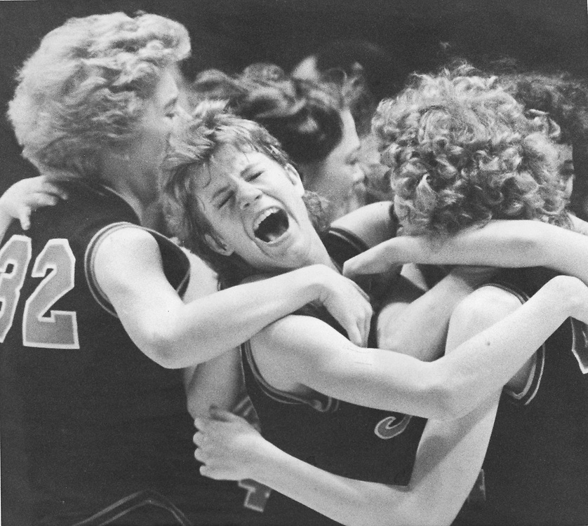 ©1989  Texas schoolgirls ecstatic after willing state title in basketball.