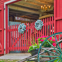 Rural Massachusetts landscape photography of a beautiful red country barn and New England farmstand at the Wayside Inn Historic District in Sudbruy, MA.<br /> <br /> New England farm stand at the Wayside Inn Historic District Red Old Barn photography images are available as museum quality photography prints, canvas prints, acrylic prints, wood prints or metal prints. Fine art prints may be framed and matted to the individual liking and decorating needs:<br /> <br /> https://juergen-roth.pixels.com/featured/new-england-farm-stand-at-the-wayside-inn-historic-district-red-old-barn-juergen-roth.html<br /> <br /> Good light and happy photo making!<br /> <br /> My best,<br /> <br /> Juergen