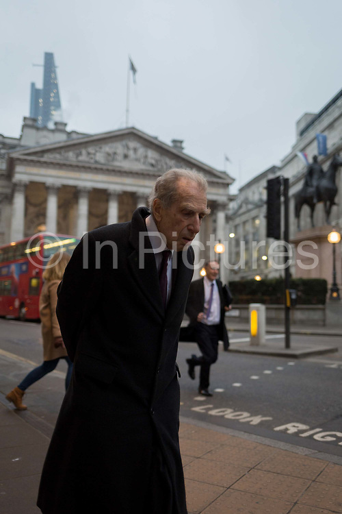 An tired-looking elderly gentleman stoops as he walks past the Bank of England, in the Square Mile, the capitals oldest district and financial centre, on 9th February 2017, in the City of London, England. Traditional City bowler hats and pinstripe suits are now rare, even among older bankers and financiers.