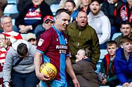 Scunthorpe United defender Anthony McMahon (4), on loan from Oxford United, has a few words with the travelling fans  during the EFL Sky Bet League 1 match between Scunthorpe United and Doncaster Rovers at Glanford Park, Scunthorpe, England on 23 February 2019.