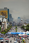 May 19 - BANGKOK, THAILAND: Smoke billows over Bangkok as seen from Rama IV Road during the Thai government crack down against Red Shirt and anti government protesters. The Royal Thai Army attacked anti-government protesters May 19 with troops and armored personnel carriers. Photo by Jack Kurtz
