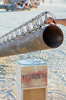Therolin no2<br /> by: Ryan Elmandorf<br /> from: Denver, CO<br /> year: 2019<br /> <br /> Therolin is a Theremin but instead of playing from a speaker the instrument is a very large guitar string electronically strummed, using an 8 inch X 20 ft pipe as a resonating body. The large pipe juts up from the playa at a very low angle. It ends at eye height. Below it's opening a small podium awaits. As the participant reaches out to touch the podium, they will notice a soft musical sound starting to emit. If they move their hand closer to the antenna, the pitch of the sound will rise, and as they move their hand away the pitch will fall. The experience will be the interface of a traditional theramin, but with a more real, physical sound in lieu of the traditional synthesized sound.<br /> <br /> URL: http://www.elmendorfgeurts.com/project/therolin<br /> <br /> https://burningman.org/event/brc/2019-art-installations/?yyyy=&artType=B#a2I0V000001AY6hUAG My Burning Man 2019 Photos:<br />