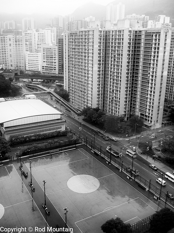 Hong Kong (Chinese: 香港) - January 27, 2006 - The soccer courts are soaked with rain during a downpour in Hong Kong.<br /> <br /> Image: © Rod Mountain<br /> <br /> www.rodmountain.com