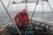 Edinburgh, Scotland. August, 2017. Robert Johnson junior controls the trawling wires with the trawl winches to pull up the trawl net on August 31, 2017 near Edinburgh, Scotland. Port Seton is one of the few East Lothian harbours to maintain a fishing fleet, but the harbour has seen a sharp drop in fishing in recent years, forcing many to abandon the industry. Father and son, with the same name, Robert Johnson, were forced to sell one of their trawlers due to a decrease in crustacean yields, but they still continue to brave the North sea conditions to bring in their daily catch.  © Simone Padovani