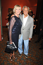 MICHAEL WINNER and his wife GERALDINE at a private view of work by Sacha Newley entitled 'Blessed Curse' in association with the Catto Gallery held at the Arts Club, Dover Street, London W1 on 2nd July 2008.<br /><br />NON EXCLUSIVE - WORLD RIGHTS