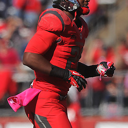 Oct 13, 2012: Rutgers Scarlet Knights running back Savon Huggins (28) returns to the sidelines after his face mask malfunctioned during NCAA Big East college football action between the Rutgers Scarlet Knights and Syracuse Orange at High Point Solutions Stadium in Piscataway, N.J.