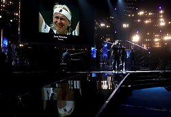 Rag n Bone man performs while photos of sports stars who passed away during the year are shown on the screen behind him during the BBC Sports Personality of the Year 2017 at the Liverpool Echo Arena.