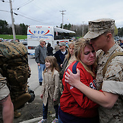 5/5/11 -- TOPSHAM, Maine.  U.S. Marine Lance Cpl. Brandon Sodergren or Waldoboro hugs his girlfriend, Amanda Sullivan of Durham before heading getting on the bus. Marine Reservists departed from Topsham on Thursday for the start of a year-long deployment to Afghanistan amidst a crowd of family, friends and well-wishers. This mission will be different from others, said several Marines, because instead of doing combat operations they will be teaching the Afghan National Army to operate independently. They travel first to California for several months of training and are planning to return in May 2012. Photo by Roger S. Duncan.