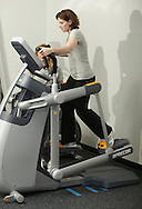 Monroe, New York - A woman uses the execise equipment at the new South Orange Family YMCA on Wednesday, Feb. 16, 2011.