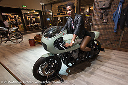 """A model on one of the """"Faster Sons"""" Yard Built customs created for Yamaha on view at EICMA, the largest international motorcycle exhibition in the world. Milan, Italy. November 19, 2015.  Photography ©2015 Michael Lichter."""