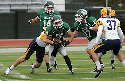 18 October 2014:  Josh Symbal (LB) wraps up ball carrier Fernando Lozano (WR)  during an NCAA division 3 football game between the Augustana Vikings and the Illinois Wesleyan Titans in Tucci Stadium on Wilder Field, Bloomington IL