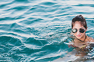 A resident of Anfeh (also spelled Enfeh) swims in the Mediterranean Sea. The town, located on the Mediterranean Sea 15 kilometers south fo Tripoli, is primarily Greek Orthodox with a minority of Maronite Christians and Sunni Muslim.