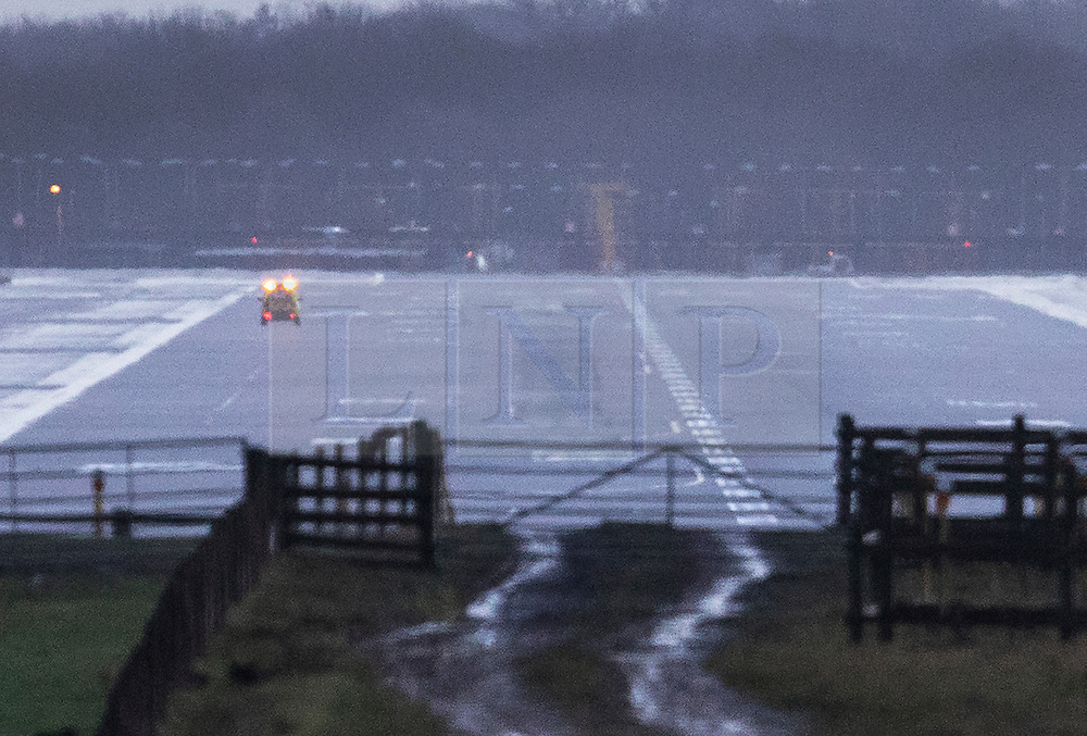 © Licensed to London News Pictures. 20/12/2018. London, UK. An emergency vehicle check the runway at Gatwick airport at first light. Flights have been cancelled and thousands of passengers have been delayed after the airport closed due to two drones being spotted nearby. Photo credit: Peter Macdiarmid/LNP