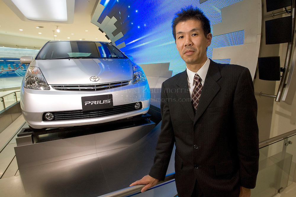 TOYOTA CITY, JAPAN  -  March 22:  Satoshi Ogiso the chief designer of the Toyota Prius inside the Toyota showroom on March 22, 2006 in Toyota City Japan. With the popularity of the Prius in America and other countries Toyota is set to overcome General Motors as the worlds largest auto manufacturer.   (Photo by David Paul Morris)