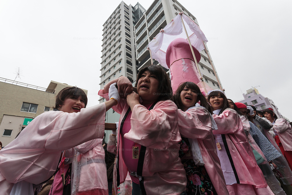 Transvestites carry a mikoshi featuring a large pink phallus during the Kanamara festival for the steel phallus in Kawasaki Daishi, Kanagawa, Japan. Sunday April 5th 2015 The Kanamara penis festival celebrates a legend about the defeat of a penis-eating demon. It is a wildly popular festival attracting large numbers of locals and foreigners.
