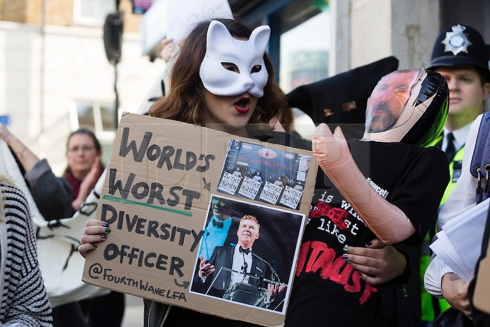 "© Licensed to London News Pictures. 31/10/2015. London, UK. A demonstrator with a placard of museum owner, Mark Palmer-Edgecumbe protests outside the Jack the Ripper Museum in Cable Street, Shadwell, east London. The protest is organised by feminist group, The Fourth Wave and attended by Class War and other activists, who are protesting against a Halloween event being held at the museum this weekend, where visitors can take selfie photographs inside the museum with ""Jack the Ripper"" and some of his female victims played by actors. Photo credit : Vickie Flores/LNP"