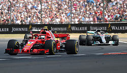 Ferrari's Sebastian Vettell (left) and Mercedes' Lewis Hamilton during the 2018 British Grand Prix at Silverstone Circuit, Towcester.