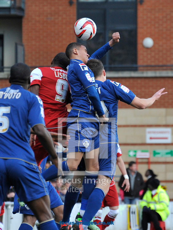 Picture by Alan Stanford/Focus Images Ltd +44 7915 056117.27/04/2013.Kevin Lisbie of Leyton Orient and Connor Brown of Oldham Athletic during the npower League 1 match at the Matchroom Stadium, London.. .