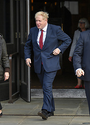 Prime Minister and party leader Boris Johnson leaves his hotel on day 2 of the Conservative Party conference in Manchester.<br /> <br /> © Dave Johnston / EEm