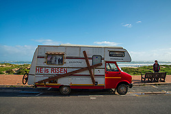 """That cross too much to bear? The owner of this RV has put it on wheels. At the front is a sign that says: """"Construction vehicle for Jesus,"""" and at the back, a bicycle. Parked on Strand beach, in Western Cape on July 15, 2020. PHOTO: EVA-LOTTA JANSSON"""