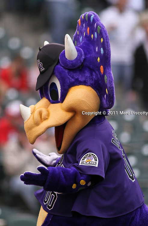 SHOT 5/28/11 5:01:38 PM - Colorado Rockies mascot Dinger before the game against the St. Louis Cardinals during their regular season MLB game at Coors Field in Denver, Co. The Rockies won the game 15-4. (Photo by Marc Piscotty / © 2011)
