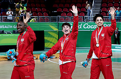 England's Stefanie Collins (centre) celebrates with her silver medal in the Women's Gold Medal Game at the Gold Coast Convention and Exhibition Centre during day ten of the 2018 Commonwealth Games in the Gold Coast, Australia.