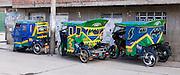 Mototaxis (three-wheeled auto rickshaws) provide cheap public transportation in Huaraz, in the Andes Mountains, Ancash Region, Peru, South America.