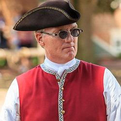 A costumed horse carriage driver at Colonial Williamsburg, VA.