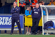 AFC Wimbledon manager Wally Downes leaning against dug out during the EFL Sky Bet League 1 match between AFC Wimbledon and Gillingham at the Cherry Red Records Stadium, Kingston, England on 23 March 2019.