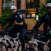 Police shadow the Black Lives Matter protesters as they march towards the capitol after gathering at Lafayette park to defy the curfew and protest the killing of George Floyd in Minneapolis.