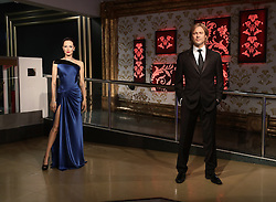 The wax figures of Brad Pitt and Angelina Jolie after they were moved apart at Madame Tussauds London following the news of their divorce.
