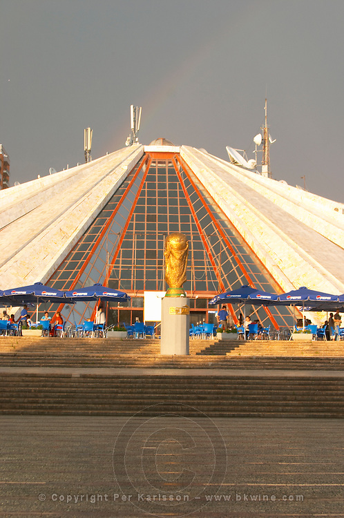 The monument mausoleum museum of the former dictator Enver Hoxa Hoxha, in pyramid shape. ray of sunshine, rainbow in the sky. Tirana capital. Albania, Balkan, Europe.