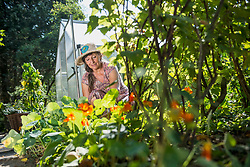 Senior woman working in garden, Altoetting, Bavaria, Germany