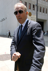 13 June 2012. New Orleans, Louisiana,  USA. .Actor Kevin Costner leaves federal court in New Orleans where he is accused of bilking investors of millions of dollars from his oil/water separating business Ocean Therapy Solutions. Costner's partners, among them the actor Stephen Baldwin sold their shares in the company before Costner allegedly struck a deal with BP to purchase the oil/water separators, without advising his business partners that he had already done the deal. Balwin and his fellow investor, Contogouris are suing Costner for $21 million. The case continues..Photo; Charlie Varley.